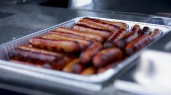 """Johnsonville celebrated the start of Milwaukee baseball with its 65-feet-long """"big taste grill."""" Fans received free brats at the event."""