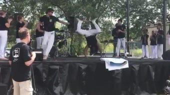 Cordão De Ouro is an Afro-Brazilian group that blends music, dance and martial arts into a single performance.
