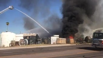 A scrapyard fire at 27th Avenue and Palm Lane in Phoenix sent a tower of thick smoke that could be seen for miles. Phoenix fire crews were able to contain the fire, but extensive damage occurred at the site.