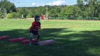 Groton football players work on conditioning and skills during drills.