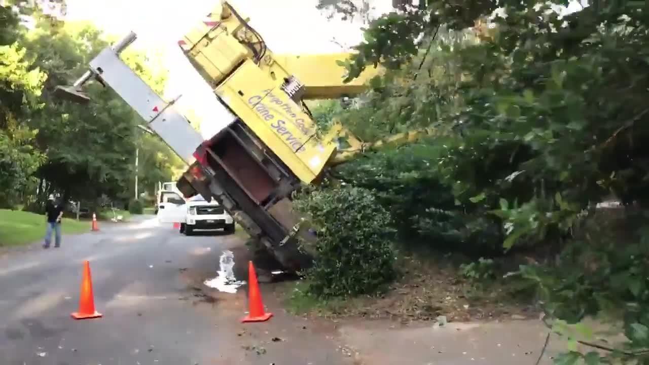 100-ton crane falls on Collins Drive house