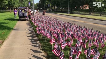Students and faculty members at Elmira College planted nearly 3,000 American flags Wednesday in memory of the victims of the Sept. 11, 2001 attacks.