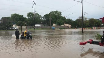 The 1900 block of Main Street was flooded after a storm Wednesday morning on the east side of Green Bay.