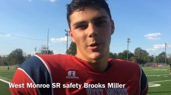West Monroe senior safety Brooks Miller (4) details what impresses him most about Longview quarterback Haynes King.