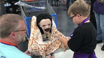 Kid who loves Halloween becomes honorary employee for a day
