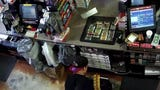 Phoenix Police Department surveillance video shows a man pushing a store clerk and stealing cigarettes and lottery tickets.