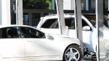 A woman drove her car into the glass wall of a Mercedes Benz dealership in Paramus.