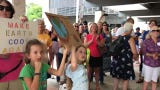 Joan Marshall sang a song she wrote to encourage environmental activists who marched through downtown Naples on Friday, Sept. 20, 2019.